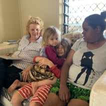 Claire and Jas on couch with kids